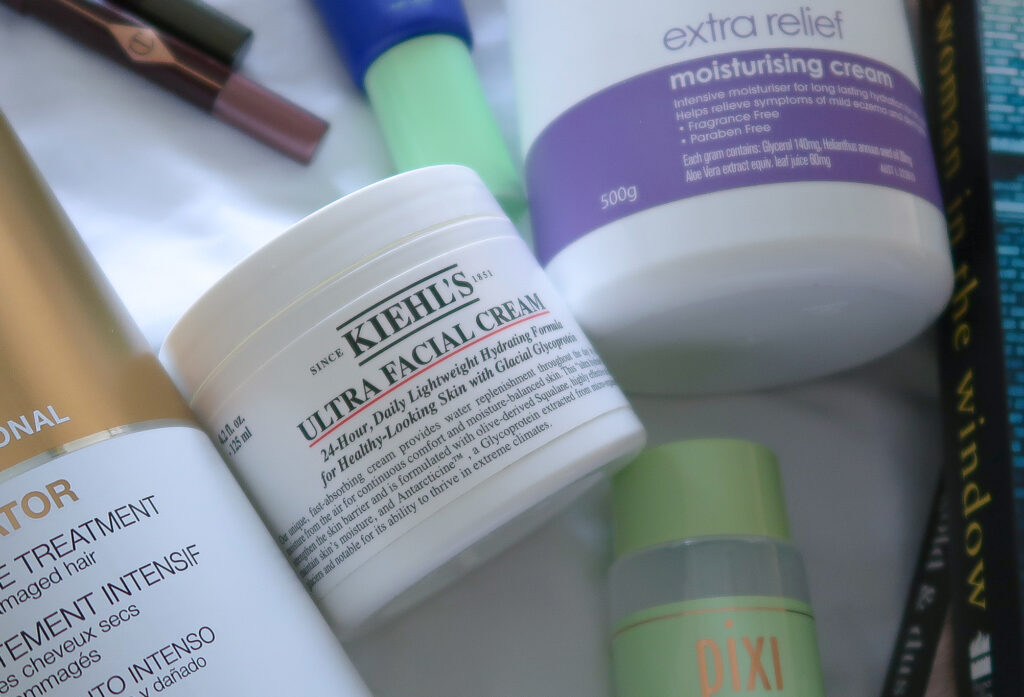 Close up of Kielhs Ultra Facial Cream tub with other favourites scattered around.